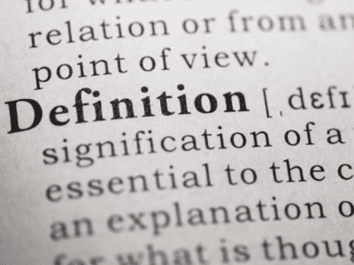 "Photo of the word ""definition"" in a dictionary."