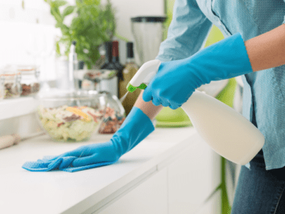 Woman wiping kitchen counter.