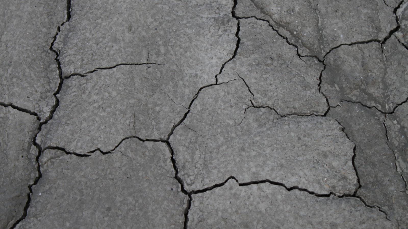 Cracking is the result of alcohol drying out the surface. Using an alcohol-based wipe or spray strips away moisture and protective coating and layers.